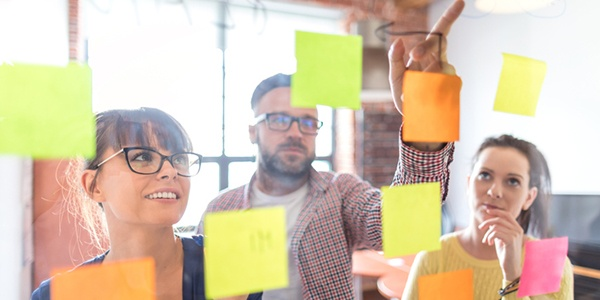 Team uses post-it notes to build an organizational alignment