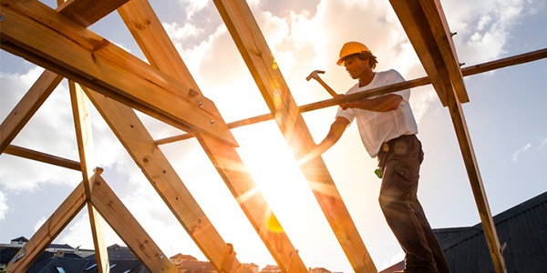 Construction worker building a roof